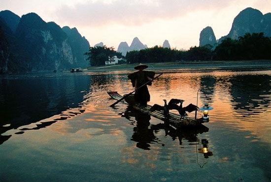 黄昏 渔人 鸬鹚 图片来源:心情爱旅行 新浪博客