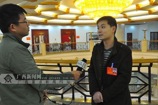 谭雨建代表接受本网记者采访。广西新闻网记者 潘晓明 摄