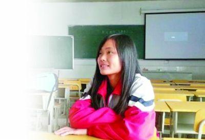 18岁的苗丹至今没有上户口。 韩飞 摄