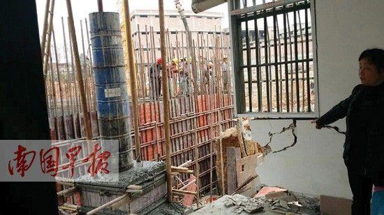 工地仍有人在施工,有关部门称是除险加固。图片来源:南国早报